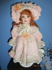 2 collectable porcelain dolls on stands