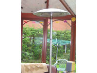 Tall self standing electric patio heater Also converts to tabletop