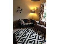 Bright two bedroomed house on quiet road with large garden.