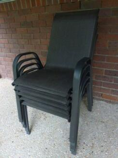 As new 6 steel framed charcoal coloured stackable outdoor chairs