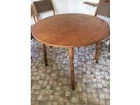 Round solid wooden dining table.