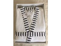 Brand new in box, lovely white full length dressing gown, with black trim, unwanted Xmas present