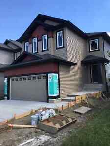 LEDUC HOME W/ SEPERATE SIDE ENTRANCE & LEGAL BSMT SUITE ROUGH-IN