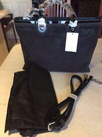 Brand new, glamorous black handbag with diamantes.