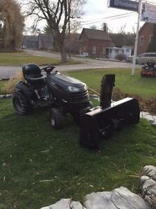 "Garden tractor with a snow blower and a 54"" cutting deck"
