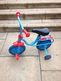 Children's blue and red bike