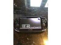 PSP Vita with case.