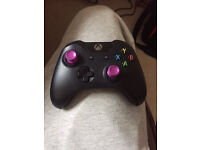 Custom Xbox One controller with purple chrome thumbsticks