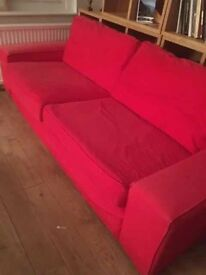 Three-seater sofa / spare bed - cream and red. Brand new extra cover . £95ono each -cover £60ono