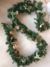 Beautiful Christmas winter rose garland with lights and decorations