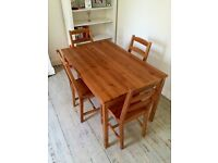 IKEA Jakkmokk table and chairs. Some very small paint marks and scratches etc. But in good condition