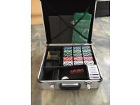 Poker Set in aluminium case, Roulette set and books. Excellent condition.