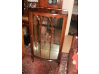 a small queen annleged china cabinet walnut veneerd .mirrored/ back/glass shelves 1930s/50s