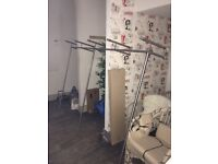 Selection of stainless steel and glass clothes rails