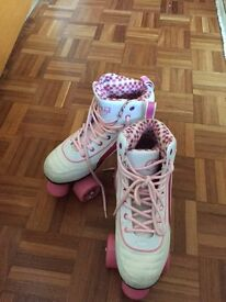 Roller Skates size 4 and holdall