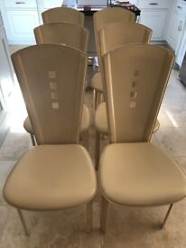 Dining chairs. Italian leather designed by Quia of Sassano. 6 chairs