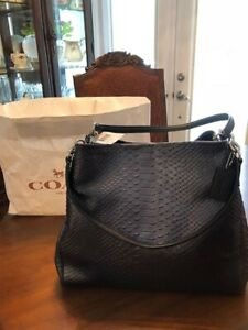 AUTHENTIC  COACH PURSE  BRAND NEW WITH TAG RETAILS FOR $550.