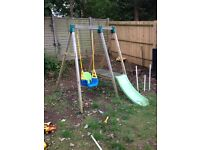 child's wooden climbing frame and swing
