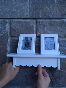 2 small shelves with picture frames