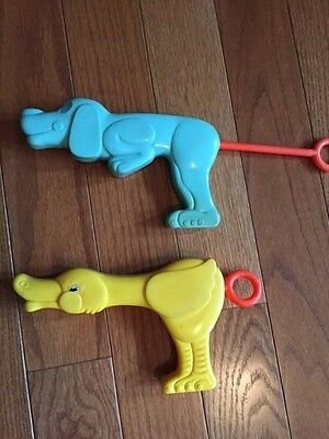 Vintage plastic squirt guns water toy dog duck ()
