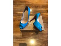 Beautiful Christian louboutin turquoise high heel shoes size 6, worn twice