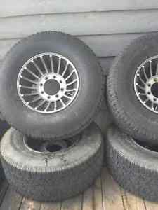 Aluminum 8 bolt rims and tires Peterborough Peterborough Area image 1