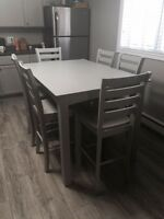Solid wood, light grey, pub style table with six chairs
