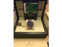 Role Submariner Blue Face Original box and papers. One owner 05 Great condition