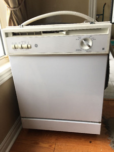 """Clean GE profile white 24"""" under the counter dishwasher"""