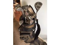 For sale Howson golf clubs and trolley.