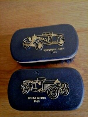 VINTAGE PAIR MEN`S CLOTHES BRUSHES WITH A 1926 GOLD COLOUR  ROLLS ROYCE & 1928