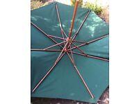 "green garden umbrella, 90"" high, 75"" diameter"