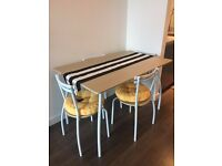 Dining table & 4 chairs with seat pads