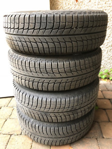 15 in. Winter Tires on Rims. Great condition. Low mileage.