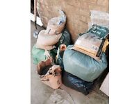 2 barrows of builders sand bagged up. Also 2 part bags of cement.