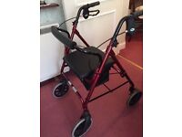 Rollator four wheel walker with seat and shopping basket