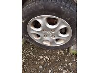 4 x peugeot alloy wheels with tyres