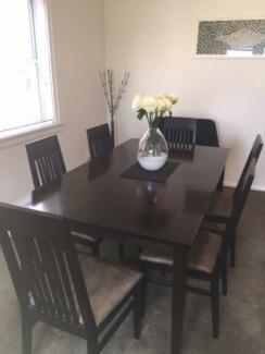 Dark wood dining table with six chairs Bondi Beach Eastern Suburbs Preview