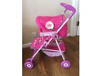 ** Pink Hello Kitty Stroller with shopping basket (foldable), excellent condition **