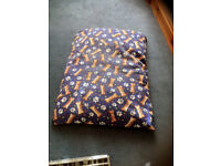 95cm x 72cm. Comfortable bed for medium sized dog. Washable cover.