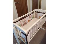 Swinging crib, mattress/bedding, crib bumper and cot mobile