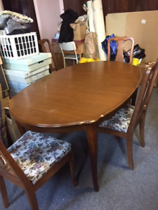 Wood dining room table and chairs