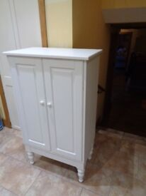 Tall Cupboard .3 deep shelves, Cream painted. Ikea. 18 months old very good condition.