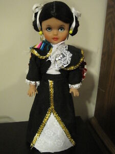 Vintage Mexican Dollie Doll on stand in Authentic Clothing