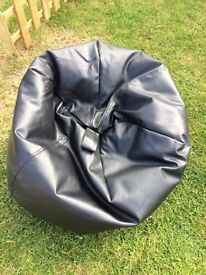 Small black faux leather beanbag chair
