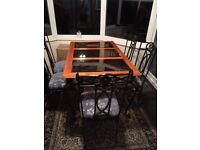 Wrought Iron Dining Table and Chairs, very good condition