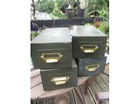 four green vintage metal index card file boxes