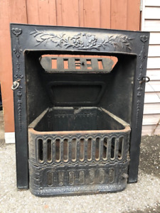 Antique fireplace cast iron hearth and wood mantel for sale.