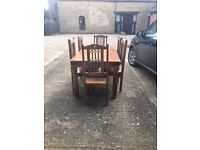Wooden dining table with 6 matching chairs, excellent condition, medieval style. Dark wood.