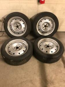 205 55 16 snow tires on 5 x 100 rims for sale